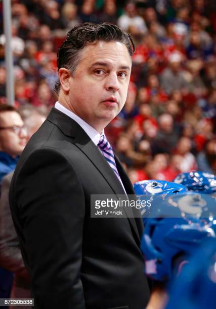 Head coach Travis Green of the Vancouver Canucks looks on from the bench during their NHL game against the Detroit Red Wings at Rogers Arena November...