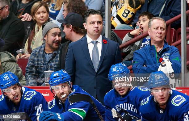 Head coach Travis Green of the Vancouver Canucks looks on from the bench during the NHL game against the Pittsburgh Penguins at Rogers Arena November...