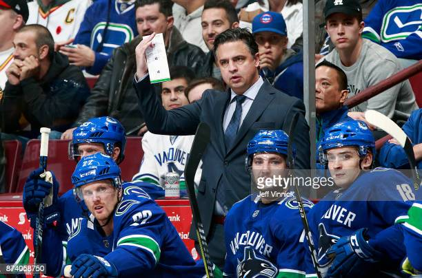Head coach Travis Green of the Vancouver Canucks looks on from the bench during their NHL game against the Dallas Stars at Rogers Arena October 30...