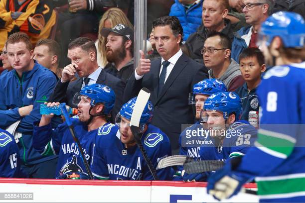 Head coach Travis Green of the Vancouver Canucks signals from the Vancouver bench during his NHL game against the Edmonton Oilers at Rogers Arena...