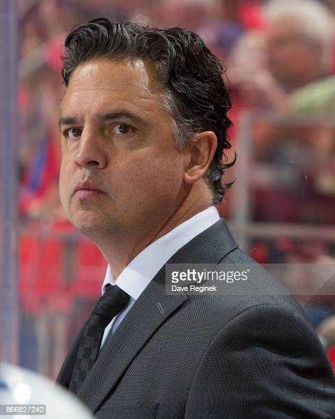 Head coach Travis Green of the Vancouver Canucks watches the action from the bench against the Detroit Red Wings during an NHL game at Little Caesars...