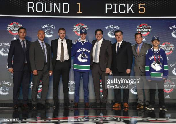 Head coach Travis Green scout David Volek draft team member fifth overall pick Elias Pettersson chairman Francesco Aquilini general manger Jim...