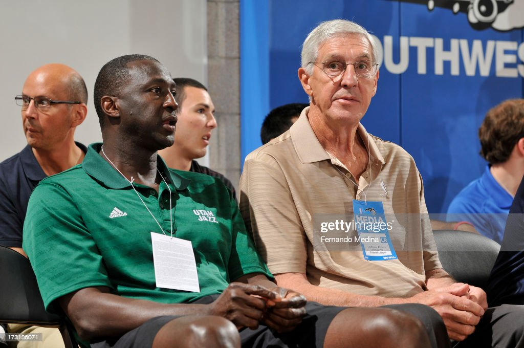 Head Coach Tyrone Corbin and Jerry Sloan of the Utah Jazz takes in the game against the Houston Rockets during the 2013 Southwest Airlines Orlando Pro Summer League on July 9, 2013 at Amway Center in Orlando, Florida.