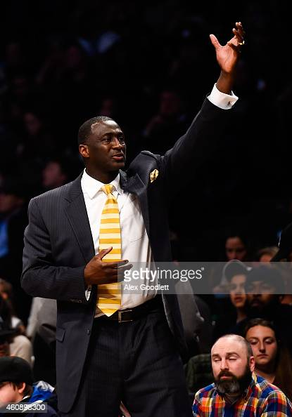 Head coach Tyrone Corbin of the Sacramento Kings looks on in the second half during a game against the Brooklyn Nets at the Barclays Center on...