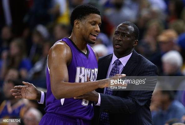 Head coach Tyrone Corbin of the Sacramento Kings talks to Rudy Gay during their game against the Golden State Warriors at ORACLE Arena on December 22...