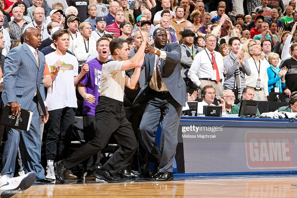 Head Coach <a gi-track='captionPersonalityLinkClicked' href=/galleries/search?phrase=Tyrone+Corbin&family=editorial&specificpeople=829288 ng-click='$event.stopPropagation()'>Tyrone Corbin</a> of the Utah Jazz calls a timeout with seconds left on the clock during play against the San Antonio Spurs at Energy Solutions Arena on December 12, 2012 in Salt Lake City, Utah.