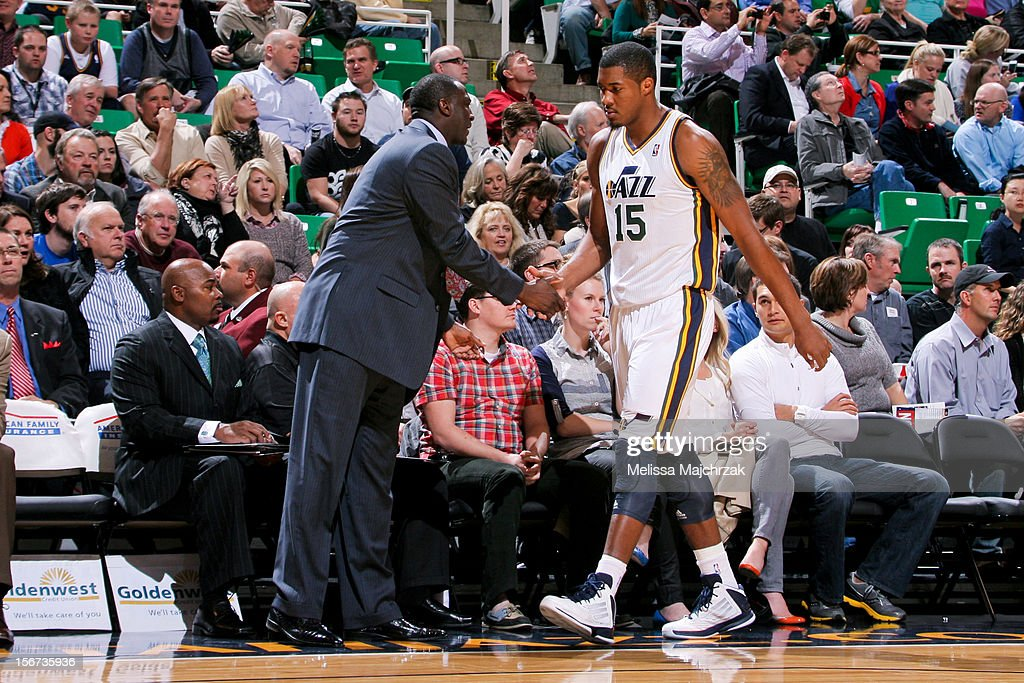 Head Coach Tyrone Corbin of the Utah Jazz greets Derrick Favors #15 during a game against the Houston Rockets at Energy Solutions Arena on November 19, 2012 in Salt Lake City, Utah.