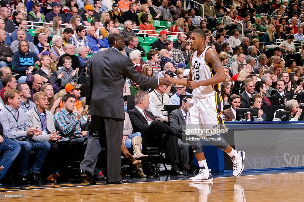 Head Coach Tyrone Corbin of the Utah Jazz greets Derrick Favors #15 during a game against the Minnesota Timberwolves at Energy Solutions Arena on January 2, 2013 in Salt Lake City, Utah.