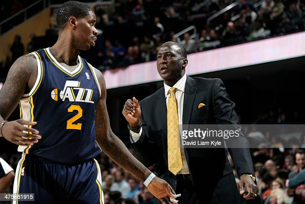 Head Coach Tyrone Corbin of the Utah Jazz talks to Marvin Williams on the sideline against the Cleveland Cavaliers at The Quicken Loans Arena on...