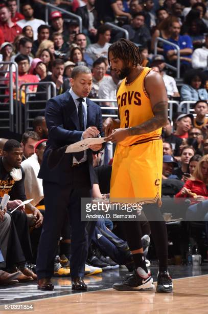 Head Coach Tyronn Lue and Derrick Williams of the Cleveland Cavaliers go over a play during a game against the LA Clippers on March 18 2017 at...