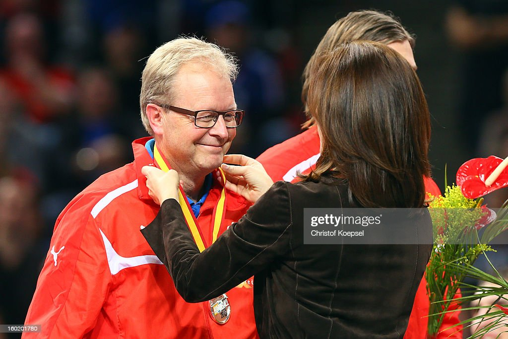 Head coach Ulrik Wilbek of Denmark gets the silver medal of Mary, crown princess of Denmark on the podium after the Men's Handball World Championship 2013 final match between Spain and Denmark at Palau Sant Jordi on January 27, 2013 in Barcelona, Spain.