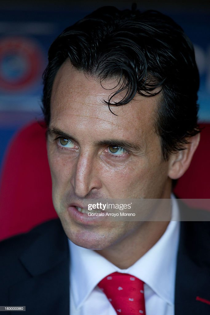 Head coach <a gi-track='captionPersonalityLinkClicked' href=/galleries/search?phrase=Unai+Emery&family=editorial&specificpeople=4599654 ng-click='$event.stopPropagation()'>Unai Emery</a> of Sevilla FC looks on sitting on the bench prior to start the UEFA Europa League group H match between Sevilla FC and SC Freiburg at Estadio Ramon Sanchez Pizjuan on October 3, 2013 in Seville, Spain.