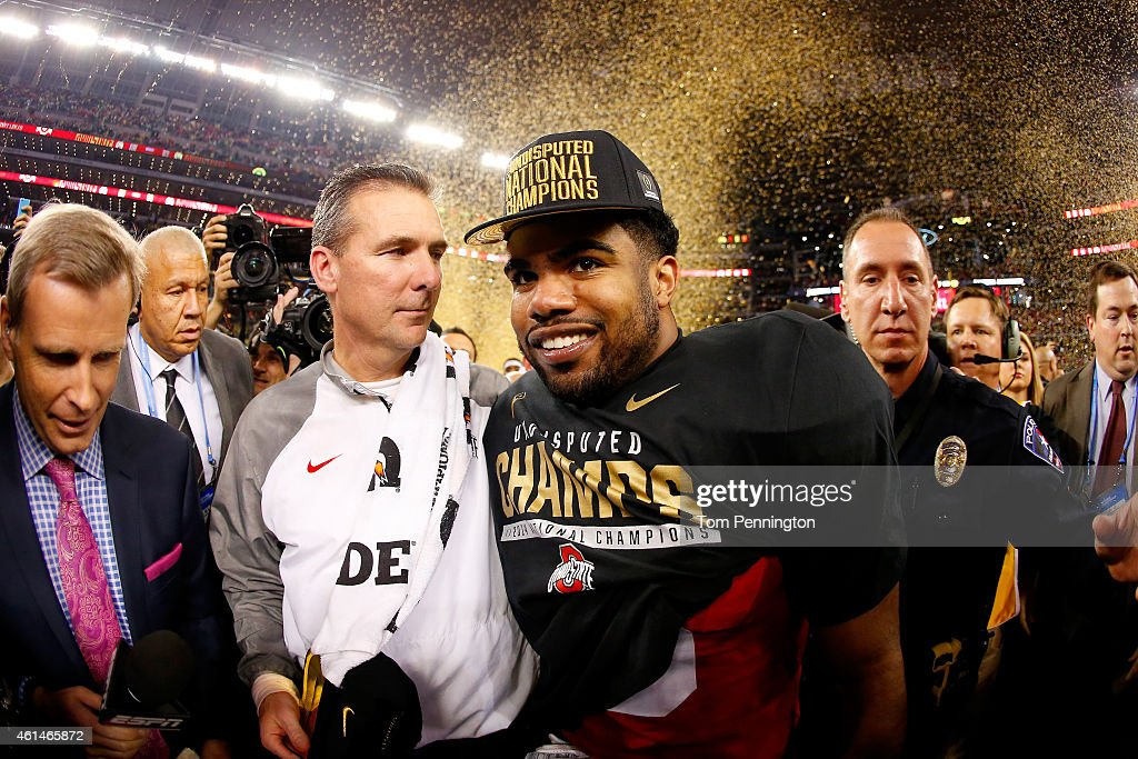 Head Coach Urban Meyer and running back Ezekiel Elliott of the Ohio State Buckeyes celebrate after defeating the Oregon Ducks 42 to 20 in the College...