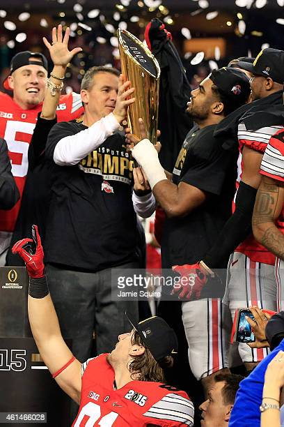 Head Coach Urban Meyer and running back Ezekiel Elliott of the Ohio State Buckeyes hoist the trophy after defeating the Oregon Ducks 42 to 20 in the...