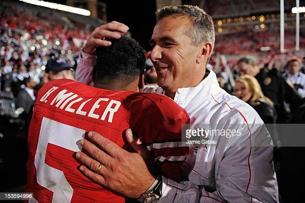 Head Coach Urban Meyer hugs quarterback Braxton Miller of the Ohio State Buckeyes after the Buckeyes defeated the Nebraska Cornhuskers 6338 at Ohio...