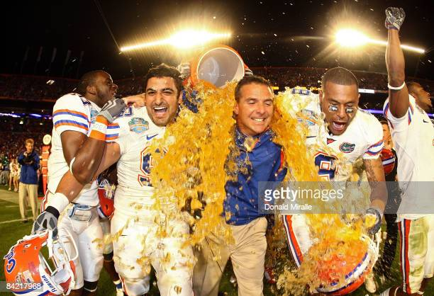 Head coach Urban Meyer of the Florida Gators gets gatorade dumped on him by his teammates towards the end of the game against the Oklahoma Sooners in...