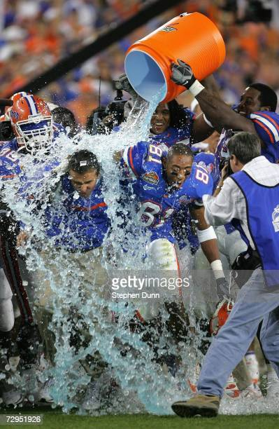 Head coach Urban Meyer of the Florida Gators is dowsed with the Gatorade bucket seconds before defeating the Ohio State Buckeyes during the fourth...