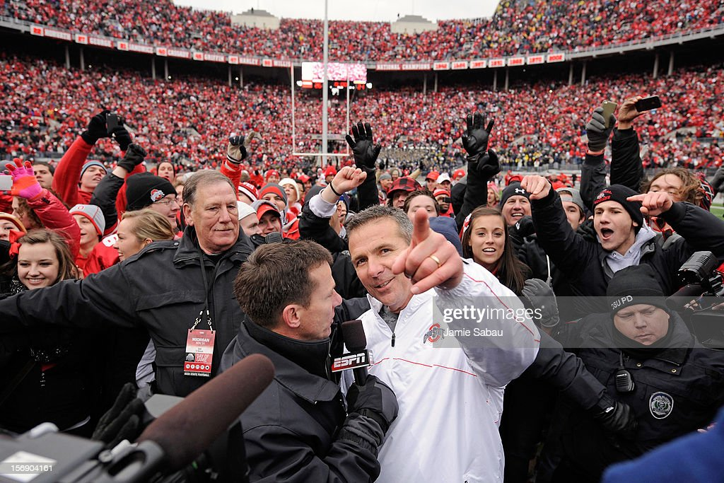 Head coach <a gi-track='captionPersonalityLinkClicked' href=/galleries/search?phrase=Urban+Meyer&family=editorial&specificpeople=2108753 ng-click='$event.stopPropagation()'>Urban Meyer</a> of the Ohio State Buckeyes celebrates the Buckeyes' 26-21 win over the Michigan Wolverines at Ohio Stadium on November 24, 2012 in Columbus, Ohio.