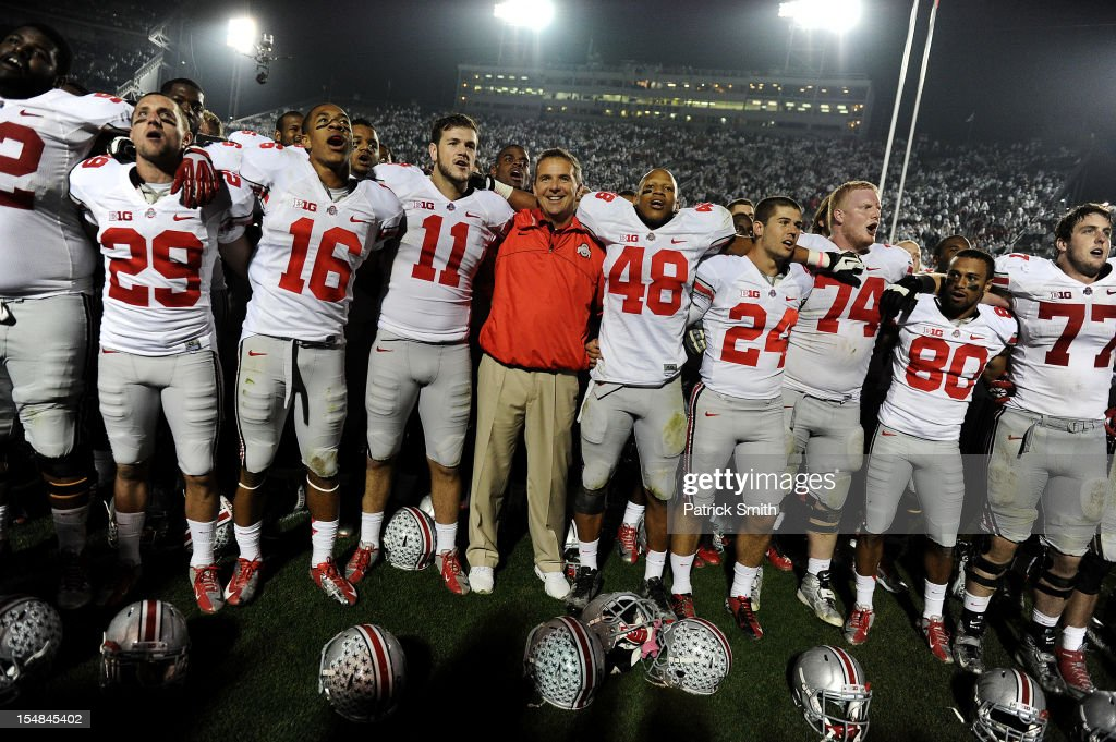 Head coach <a gi-track='captionPersonalityLinkClicked' href=/galleries/search?phrase=Urban+Meyer&family=editorial&specificpeople=2108753 ng-click='$event.stopPropagation()'>Urban Meyer</a> of the Ohio State Buckeyes celebrates with his team after defeating the Penn State Nittany Lions at Beaver Stadium on October 27, 2012 in State College, Pennsylvania. The Ohio State Buckeyes won 35-23.