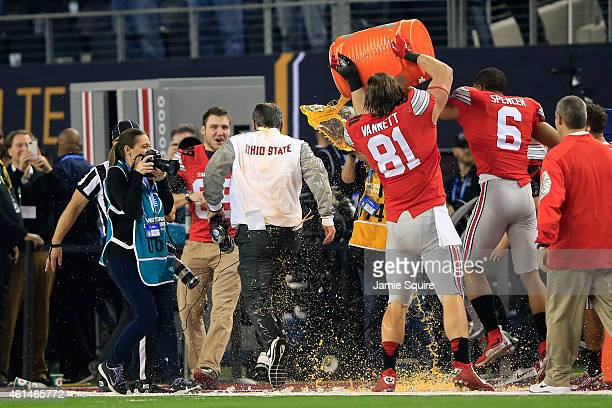 Head Coach Urban Meyer of the Ohio State Buckeyes gets dunked with Gatorade in the fourth quarter against the Oregon Ducks during the College...