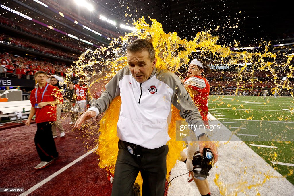 Head Coach Urban Meyer of the Ohio State Buckeyes gets dunked with Gatorade by tight end Nick Vannett #81 in the fourth quarter against the Oregon Ducks during the College Football Playoff National Championship Game at AT&T Stadium on January 12, 2015 in Arlington, Texas.
