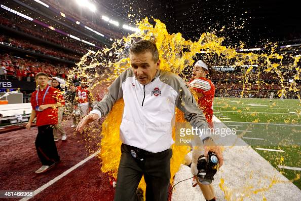 Head Coach Urban Meyer of the Ohio State Buckeyes gets dunked with Gatorade by tight end Nick Vannett in the fourth quarter against the Oregon Ducks...