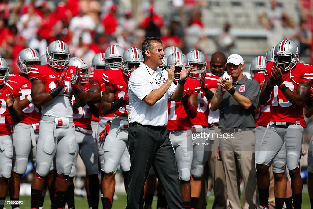 Head Coach Urban Meyer of the Ohio State Buckeyes helps to excite his team prior to the start of their game against the Buffalo Bulls on August 31, 2013 at Ohio Stadium in Columbus, Ohio. Ohio State defeated Buffalo 40-20.