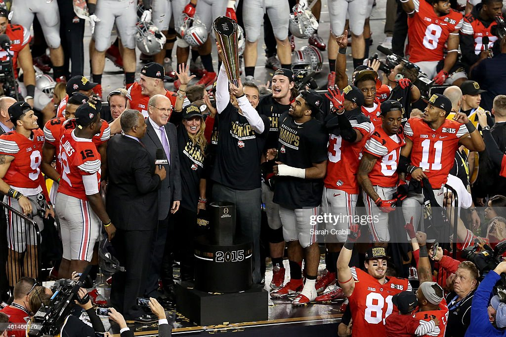 Head Coach Urban Meyer of the Ohio State Buckeyes hoist the trophy after defeating the Oregon Ducks 42 to 20 in the College Football Playoff National Championship Game at AT&T Stadium on January 12, 2015 in Arlington, Texas.