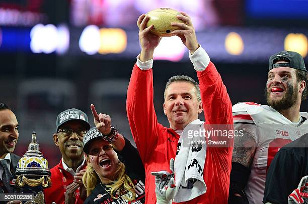 Head coach Urban Meyer of the Ohio State Buckeyes holds the Fiesta Bowl trophy after the BattleFrog Fiesta Bowl at University of Phoenix Stadium on...