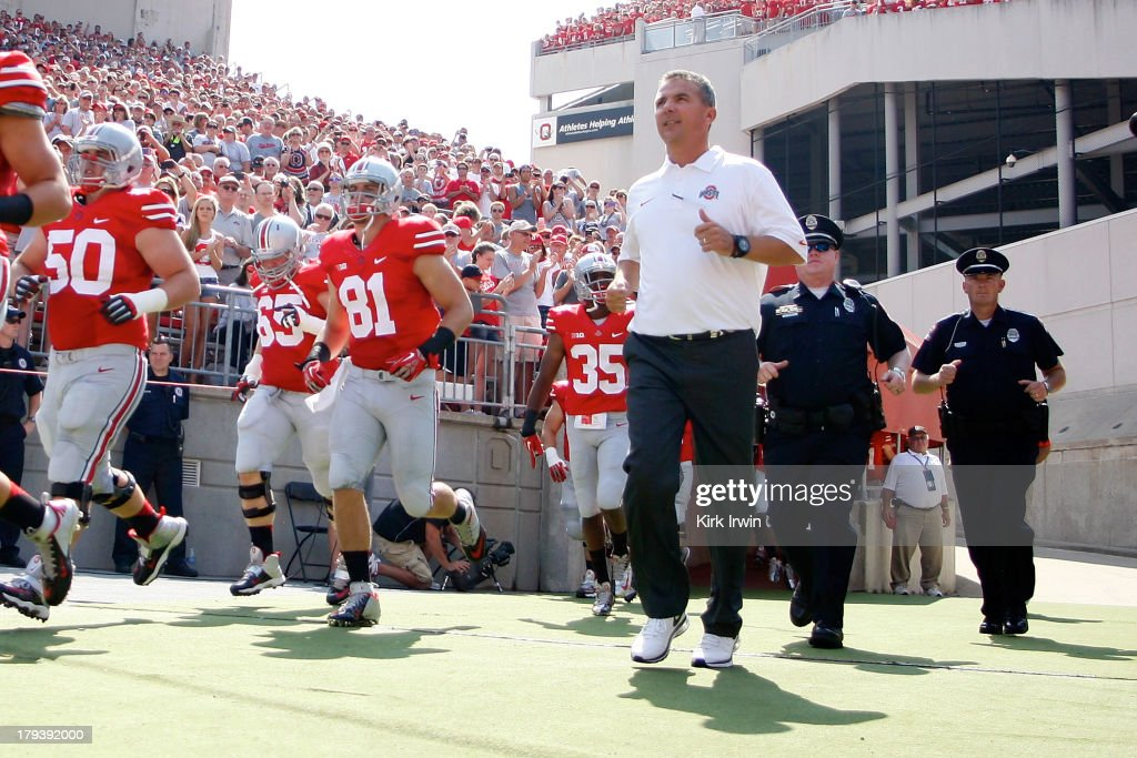 Head Coach Urban Meyer of the Ohio State Buckeyes makes his way onto the field prior to the start of the game against the Buffalo Bulls on August 31, 2013 at Ohio Stadium in Columbus, Ohio. Ohio State defeated Buffalo 40-20.