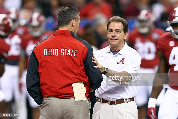 Head coach Urban Meyer of the Ohio State Buckeyes shakes hands with head coach Nick Saban of the Alabama Crimson Tide prior to the All State Sugar...