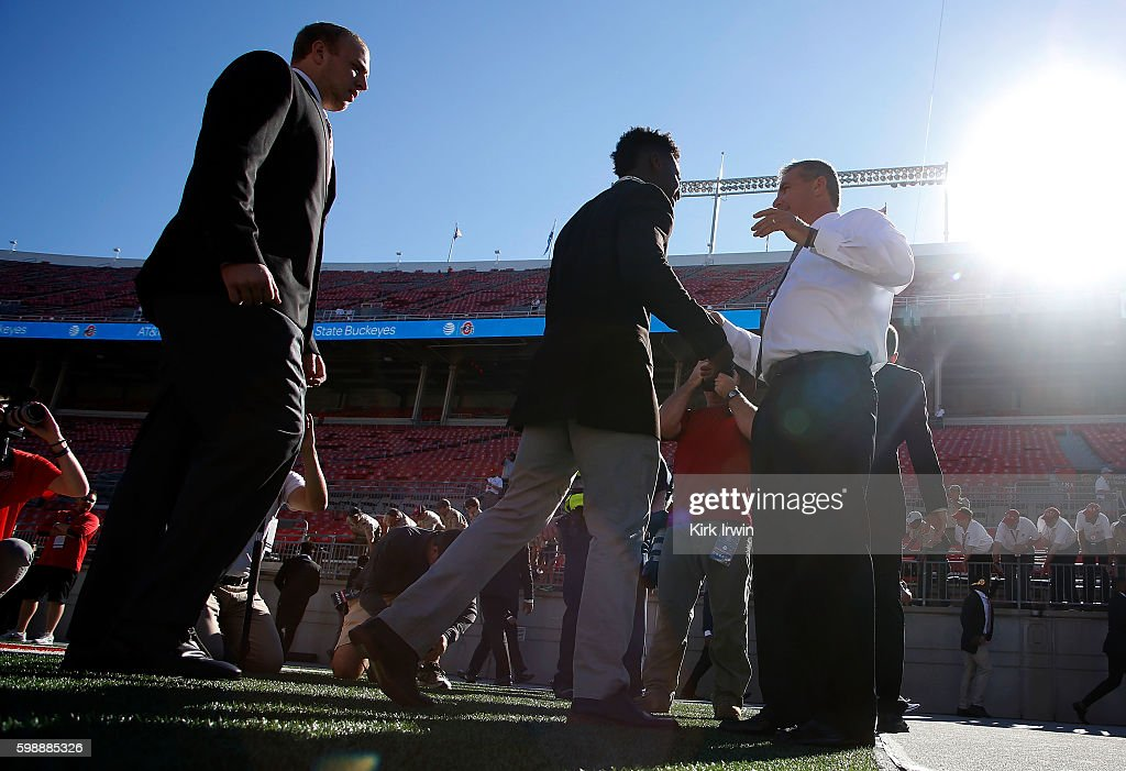 Head Coach Urban Meyer of the Ohio State Buckeyes shakes hands with players prior to the start of the game against the Bowling Green Falcons on September 3, 2016 at Ohio Stadium in Columbus, Ohio.