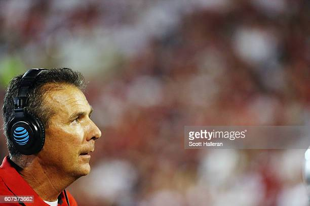 Head coach Urban Meyer of the Ohio State Buckeyes waits for a play on the field in the second half of their game against the Oklahoma Sooners at...