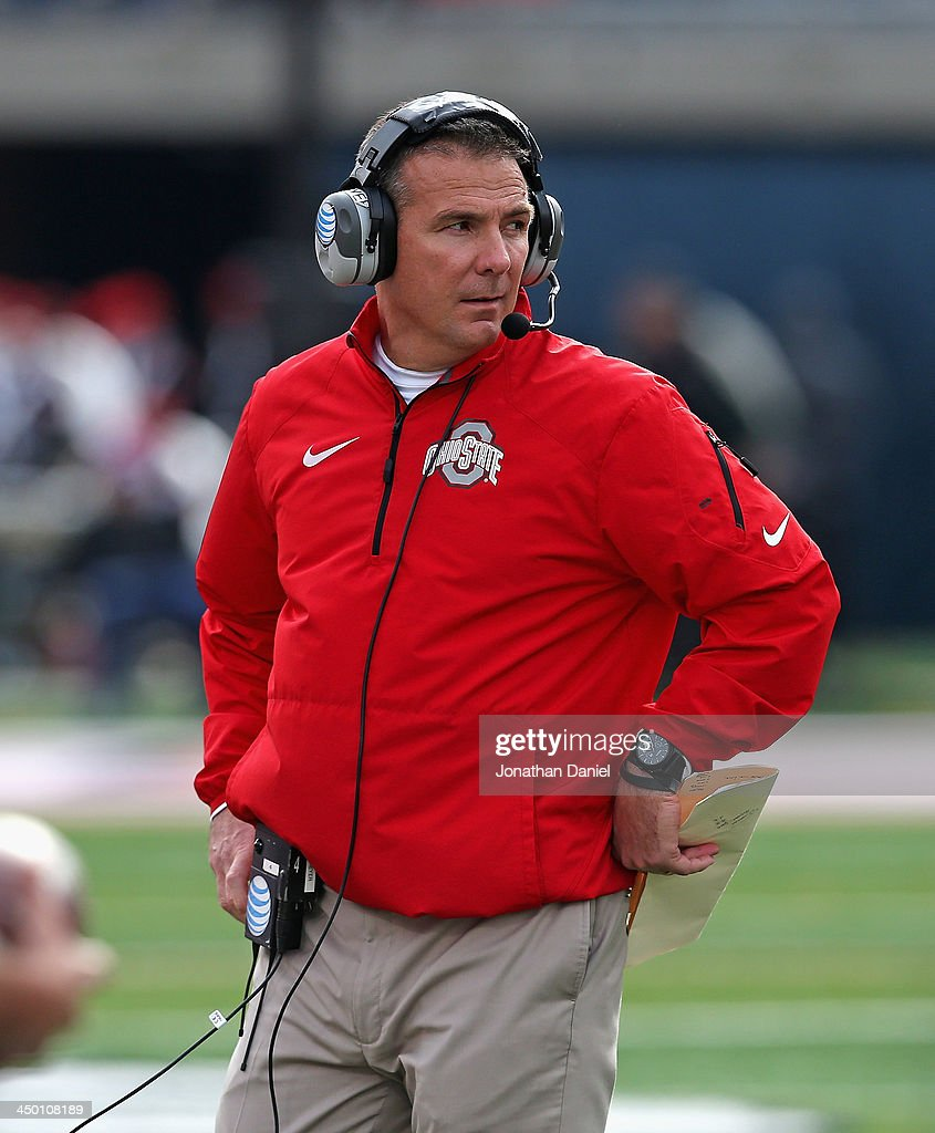 Head coach Urban Meyer of the Ohio State Buckeyes watches as his team takes on the Illinois Fighting Illini at Memorial Stadium on November 16, 2013 in Champaign, Illinois.