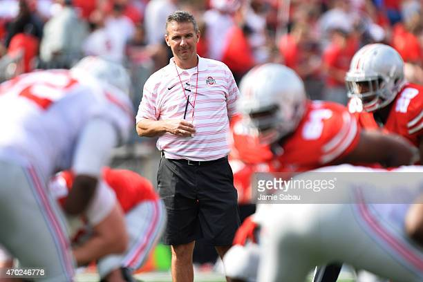 Head Coach Urban Meyer of the Ohio State Buckeyes watches his team scrimmage against each other during the annual Ohio State Spring Game at Ohio...