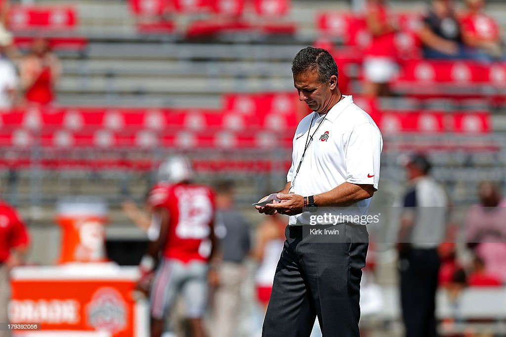 Head Coach Urban Meyer of the Ohio State Buckeyes watches over his team as they warm up prior to the start of their game against the Buffalo Bulls on August 31, 2013 at Ohio Stadium in Columbus, Ohio. Ohio State defeated Buffalo 40-20.