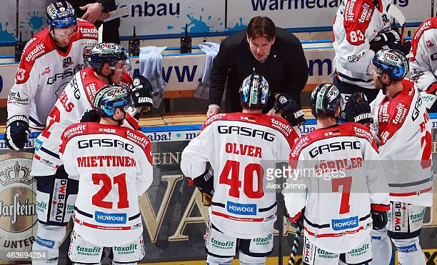 Head coach Uwe Krupp of Berlin talks to the players during a timeout during the DEL match between Adler Mannheim and Eisbaeren Berlin at SAP Arena on...