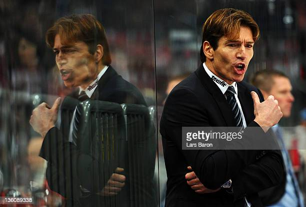 Head coach Uwe Krupp of Koeln looks on during the DEL match between Koelner Haie and Eisbaeren Berlin at Lanxess Arena on December 23 2011 in Cologne...