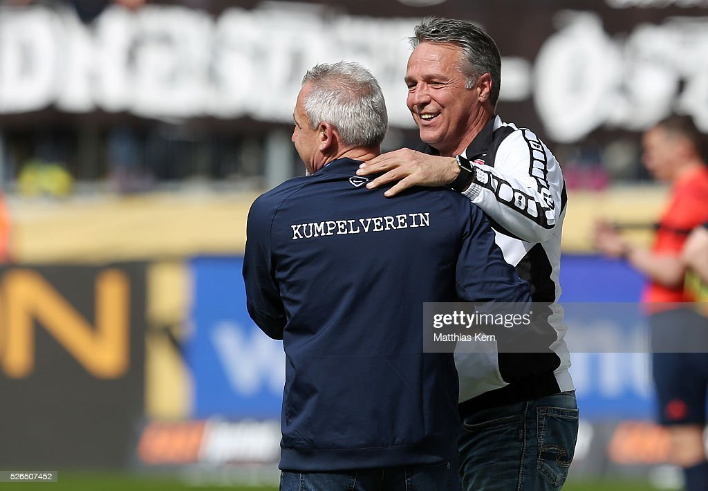 Head coach Uwe Neuhaus (R) of Dresden and head coach Pavel Dotchev (L) of Aue look on during the third league match between SG Dynamo Dresden and Erzgebirge Aue at DDV Stadion Dresden on April 30, 2016 in Dresden, Germany.