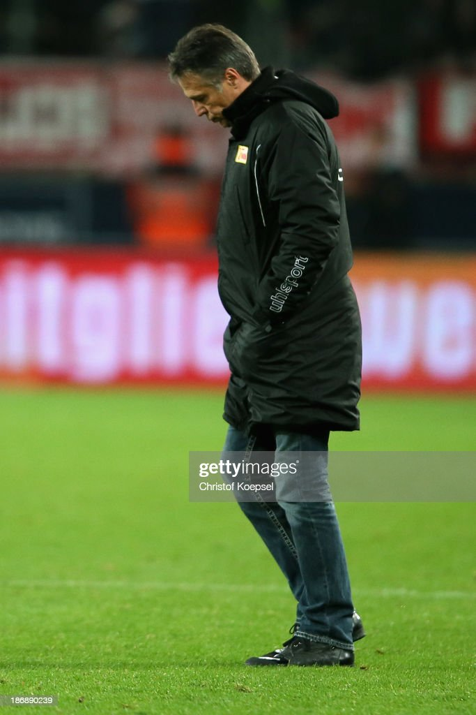 Head coach Uwe Neuhaus of Union Berlin looks dejected after the Second Bundesliga match between 1. FC Koeln and 1. FC Union Berlin at RheinEnergieStadion on November 4, 2013 in Cologne, Germany. The match between Koeln and Union Berlin ended 4-0.