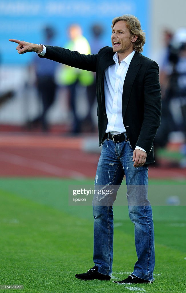 Head coach <a gi-track='captionPersonalityLinkClicked' href=/galleries/search?phrase=Valeri+Karpin&family=editorial&specificpeople=2382693 ng-click='$event.stopPropagation()'>Valeri Karpin</a> of FC Spartak Moscow gestures during the Russian Premier League match betweenn FC Ural Sverdlovsk Oblast and FC Spartak Moscow at the Tcentralny Stadium on July 21, 2013 in Ekaterinburg, Russia.