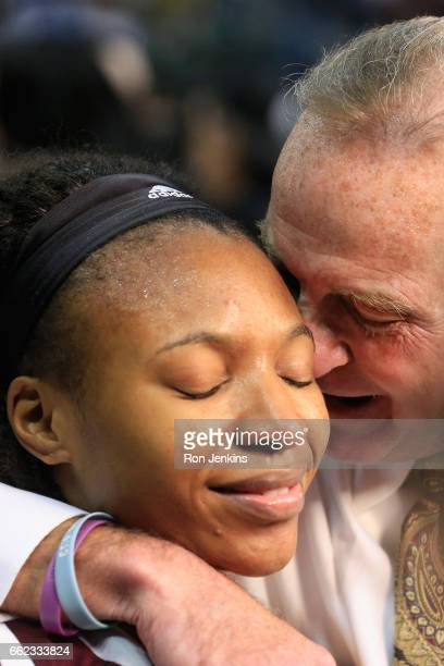 Head coach Vic Schaefer of the Mississippi State Lady Bulldogs celebrates with Morgan William after her gamewinning shot to defeat the Connecticut...