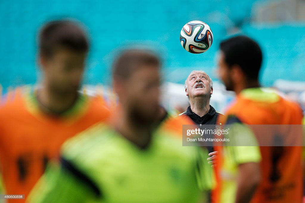 Head Coach, Vicente del Bosque juggles the ball on his head as the players warm up during the Spain training session ahead of the 2014 FIFA World Cup Group B match between Spain and the Netherlands held at the Arena Fonte Nova on June 12, 2014 in Salvador, Brazil.