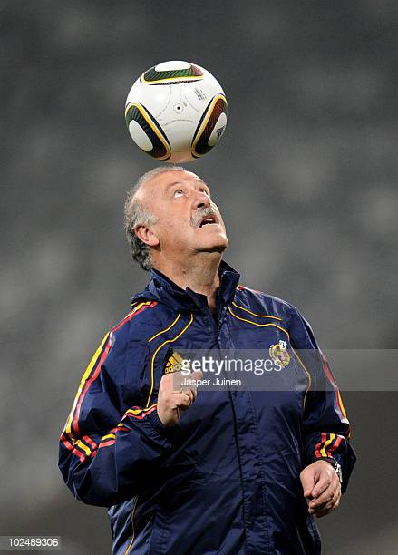 Head coach Vicente del Bosque of Spain heads a ball during a training session ahead of their 2010 World Cup Stage 2 Round of 16 match against...