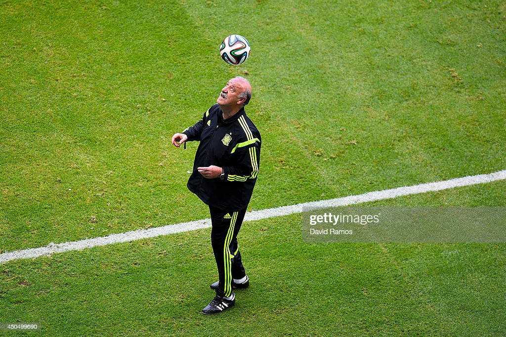 Head coach Vicente Del Bosque of Spain heads the ball during the Spain training session ahead the 2014 FIFA World Cup Group B match between Spain and Netherlands at Arena Fonte Nova on June 12, 2014 in Salvador, Brazil.