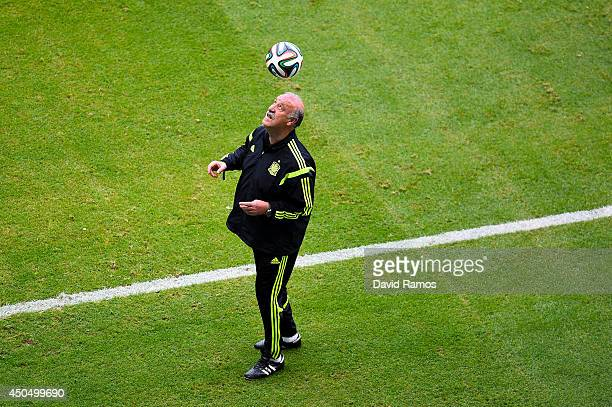 Head coach Vicente Del Bosque of Spain heads the ball during the Spain training session ahead the 2014 FIFA World Cup Group B match between Spain and...