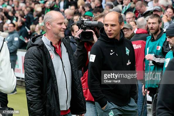 Head coach Viktor Skripnik of Bremen and Head coach Thomas Schaaf of Frankfurt walk in to the First Bundesliga match between SV Werder Bremen and...
