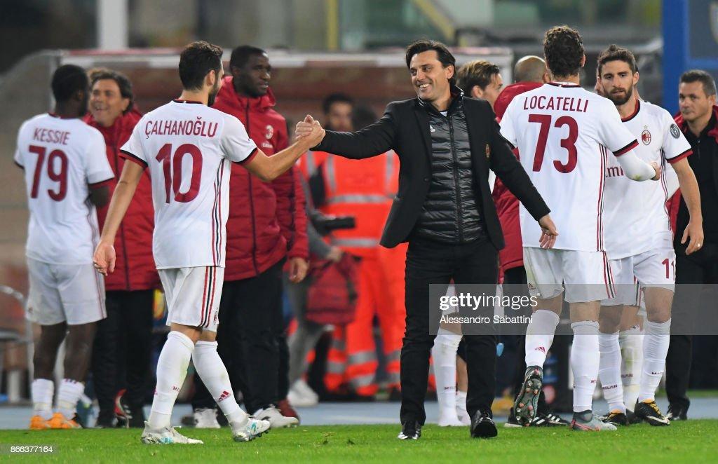 head coach Vincenzo Montella (C) of AC Milan embraces Hakan Calhanoglu of AC Milan during the Serie A match between AC Chievo Verona and AC Milan at Stadio Marc'Antonio Bentegodi on October 25, 2017 in Verona, Italy.