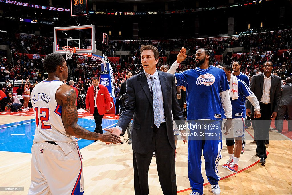 Head Coach Vinny Del Negro of the Los Angeles Clippers greets Eric Bledsoe #12 after the team's victory, their 12th straight, against the Sacramento Kings at Staples Center on December 21, 2012 in Los Angeles, California.