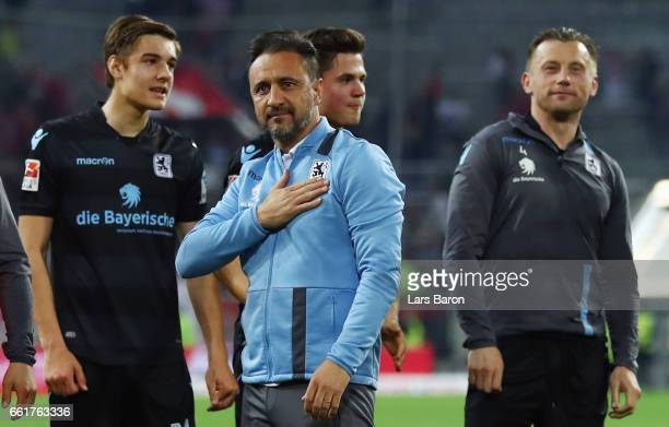 Head coach Vitor Pereira and players of 1860 Muenchen celebrate with the fans after the Second Bundesliga match between Fortuna Duesseldorf and TSV...